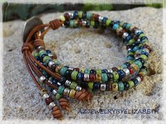 BEADED WRAP BRACELET/ BOHO SEED BEAD LEATHER WRAP BRACELET/ BEADED LEATHER WRAP/ BOHEMIAN LEATHER AND SEED BEAD WRAP BRACELET/ MULTI-COLOR. YOU HAVE YOUR CHOICE OF MANY BUTTONS. IF THERES AN ITEM WITH A PARTICULAR BUTTON YOUD LIKE ON ANOTHER LEATHER WRAP BRACELET, PLEASE LET ME KNOW. PLEASE MEASURE YOUR WRIST SIZE BEFORE YOU ORDER THANK YOU FOR STOPPING BY, PLEASE CONTACT ME IF YOU HAVE ANY QUESTIONS. PLEASE READ MY SHOP POLICIES BEFORE PURCHASE: THIS IMAGE IS SHOT IN N...