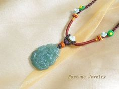 $59.00 Mercy lotus Buddha Hand Carved Green Jadeite Jade Gemstone Pendant Necklace, Hand Knotted Jade Flower decorated Cord 66 -80 cm - Fortune Feng Shui Jade Jewelry by Fortune Jewelry & Healing Beauty, http://www.amazon.com/dp/B00DABAIOO/ref=cm_sw_r_pi_dp_MjmTrb1ZC5QMW