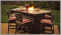 Bar height patio dining set with fire pit