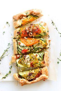 Heirloom tomato, zucchini, caramelized onion and feta galette recipe—perfect for summer entertaining al fresco!
