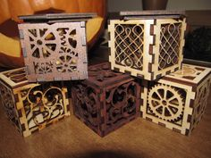 Wooden laser cut boxes. I work at a sign shop & we have a laser router for wood & metal so I could actually do this!