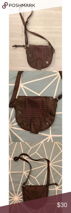 Brown Boho Embroidered Crossbody Bag This brown braided stitching crossybody purse is a playful, round satchel that embodies the freewheeling attitude of every girl. The sides are stretched out but everything else is in perfect condition! 3 pockets on the inside.   The lengthy adjustable strap can be slung over the shoulder for added movement.  • Fast shipping! Same day/ Next morning depending on when purchased.  • Bundled discounts Urban Outfitters Bags Crossbody Bags