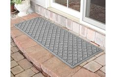Welcome guests while curbing dirt and moisture with this delightfully stylish doormat. Its unique ridged design traps debris and the hardy polypropylene fiber construction resists mildew, mold and rot. Outdoor Doors, Indoor Outdoor, Outdoor Living, Water Dam, Back Doors, At Home Store, Home Accents, Bordeaux, Aqua