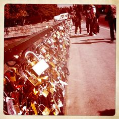 """Pont des Arts: Its a place in paris where couples """"lock"""" their love onto the fence and throw the key out into the water. Thats so amazing."""