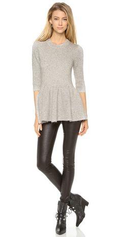 Peplum sweater with leather leggings