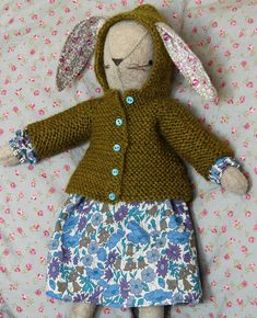 Posie Gets Cozy. Adorable bunny pattern with optional knitted accessory patterns. So stinkin' cute!