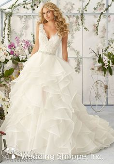 Mori Lee 2805: A lace v-neck wedding dress with ruffled skirt.