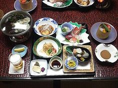 Japanese Dinner at an onsen ryokan which has a natural hot spring.