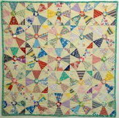 Kaleidoscope Quilt with feedsack flour fabrics.