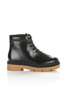 """Lace up platform boot with flat, waxy cotton laces and padded collar. Rubber heeled lug bottom.This item runs true to size.LeatherPLATFORM height: 1.2"""" (30 mm)Made in China.Dust bag included."""