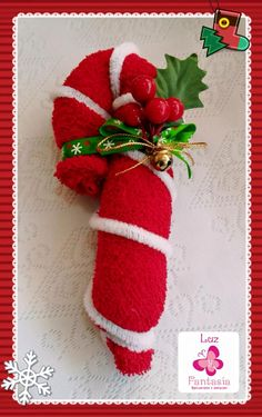 Next winter it'd be cute to make scarves in Candy Cane colors and roll them like this to hang on the tree..