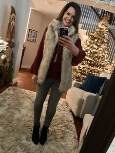 Fur vest, bell sleeve blouse, gray jeans winter outfit.  12 Cozy Winter Outfits + Where to Shop for Them http://getyourprettyon.com/12-cozy-winter-outfits-shop/?utm_campaign=coschedule&utm_source=pinterest&utm_medium=Alison%20Lumbatis%20%7C%20Get%20Your%20Pretty%20On&utm_content=12%20Cozy%20Winter%20Outfits%20%2B%20Where%20to%20Shop%20for%20Them