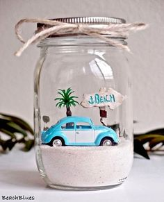 Adorable decorating ideas with Mason glass jars, capturing the beach! Featured on Completely Coastal.