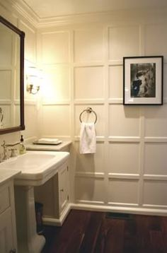 paneling look made with simple moulding and painting all one color - adds sophistication to a small space