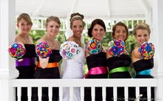 love the fabric flowers and the pops of color in the sashes