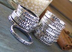 Personalized stackable stacking rings...hand stamped fine silver stacking rings.. $18.00, via Etsy.  With your child's name on it.    Ohhh these are too cool and so nicely priced!!! What's my ring size?!!