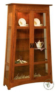 Custom Amish furniture, like our Palecek Display Case, lets you choose your domestic hardwood, stain, and hardware within our artisan's unique design.