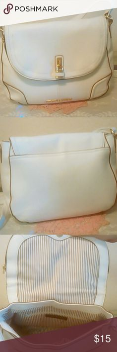 """Christian Siriano white purse It's a Christian Siriano adjustable strap purse. It's beautiful inside and outside. I take care of my items. No rips or stains. The inside has stripes and the color is lite brown with cream. I love the cute little lock on the outside. It's just for looks. I get definitely compliments about this purse being cute. The height is 9 1/2"""" and the width is 13 1/4"""". This purse is adorable for sure. Christian Siriano Bags Hobos"""