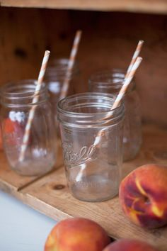 drink station ideas. rustic drink station, peach themed wedding. Design by Swoon Vintage Rentals. Flowers by Bloomers. Photography by M. Felt Photography