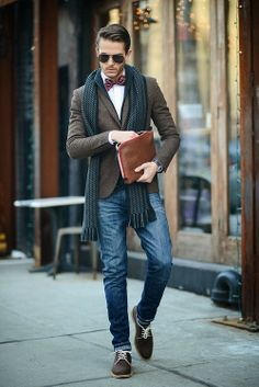 Shop this look for $295: http://lookastic.com/men/looks/bow-tie-and-dress-shirt-and-shawl-cardigan-and-scarf-and-blazer-and-jeans-and-oxford-shoes/1262 — Red Plaid Bow-tie — White Dress Shirt — Navy Shawl Cardigan — Navy Print Scarf — Dark Brown Wool Blazer — Blue Jeans — Brown Suede Oxford Shoes