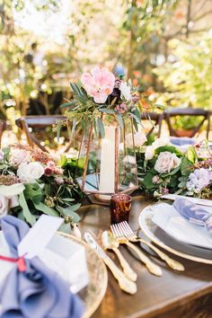 copper himmeli lantern for the reception table is dressed with a cluster of burgundy dahlia, light pink parrot tulip, ivory spray roses, heather, olive & seeded eucalyptus, set along a garland of seeded eucalyptus, salal and olive leaf.
