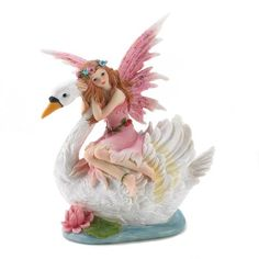 Fairy Riding Swan Bank  Here is a doe-eyed nymph Fairy gliding along on the back of a glorious Swan in a fairy tale scene looks like it could to life. This magical figurine has a hidden secret, which it is a coin bank that will helps you save up to achieve your fondest dreams. It is constructed from Polynesian.