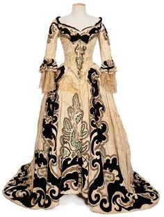 Marie Antoinette, 1938  Costume design: Adrian  cream and black velvet gown worn by Norma Shearer in the role of Marie Antoinette
