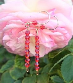 Check out this item in my Etsy shop https://www.etsy.com/au/listing/519350479/gold-plated-ear-wire-red-crystal-bicone