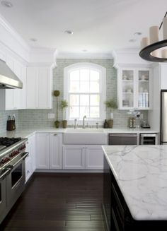 hand scraped hardwood floors, backsplash, marble countertops