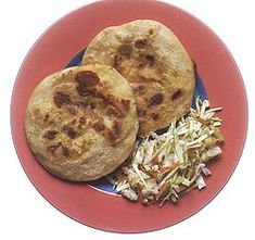 A pupusa is a traditional Salvadoran dish made of a thick, handmade corn tortilla (made using masa de maíz, a maize flour dough used in Latin American cuisine) that is usually filled with a blend of the following: cheese (queso) (usually a soft cheese called Quesillo found in all Central America), cooked pork meat ground to a paste consistency (called chicharrón, not to be confused with fried pork rind, which is also known as chicharrón , refried beans or cheese.