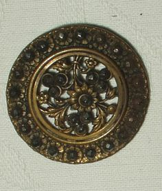 The Gatherings Antique Vintage - 2 Victorian Brass Metal Pierced Center Floral Buttons Shank Back, $4.00 (http://store.the-gatherings-antique-vintage.net/2-victorian-brass-metal-pierced-center-floral-buttons-shank-back/)