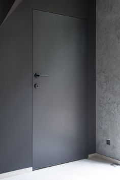 Black Interior Doors - Dramatic Or Conventional? When you need a truly dramatic, dramatic look, nothing is more dramatic than the use of black interior doors. Black doors give you the kind of feel that . The Doors, Wood Doors, Windows And Doors, H Design, House Design, Dark Interior Doors, Invisible Doors, Main Door Design, Modern Office Design