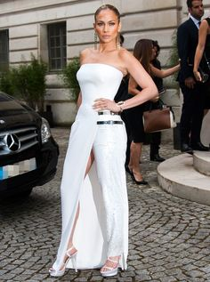 Jennifer Lopez at Atelier Versace fall 2014. Gown / pants hybrid.  The makeup up close is lacking.  The bronzer was overdone.
