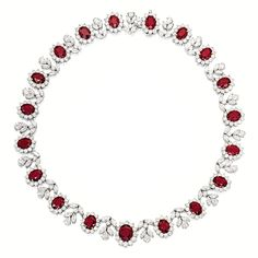 RUBY AND DIAMOND NECKLACE Composed of nineteen graduated oval rubies together weighing approximately 38.50 carats, embellished by brilliant-cut, pear- and marquise-shaped diamonds together weighing approximately 23.20 carats, mounted in platinum and 18 karat yellow gold, length approximately 400mm