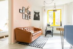 Mid century modern interior in Amsterdam apartment, with hints of pastel, geometric shapes & copper details. Gallery wall and vintage 1950s Artifort Geoffrey Harcourt cognac leather sofa