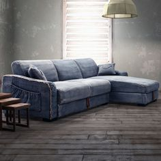 Denim-upholstered sectional sofa with under seat storage.                    1980...J   Product: Sectional sofaConstruction Material: Denim fab...