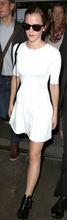 Who made  Emma Watsons black sunglasses, white short sleeve dress, and black buckle boots that she wore in Nice on May 14, 2013?