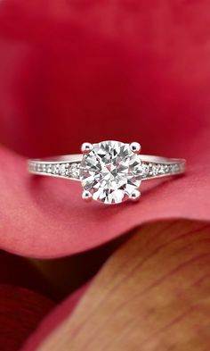 In this timeless design with distinctive details, pavé set diamonds embellish the band, gradually increasing in size as they approach the center gemstone. Milgrain detailing adds a vintage appeal.