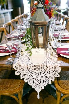 Wooden Lanterns And Crochet Table Runner With Burgundy Napkins And Custom  Place Cards For Rustic Fall