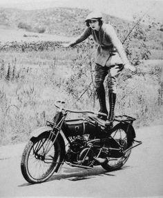 Biker chick doing biker tricks. www.TraceyCramerKelly.com