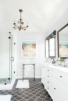 Keep up with tile trends. Fish scale tiles are a great way to update your kitchen or bathroom. Replace your subway tile with fish scale tile to stay on trend. For more design ideas and inspiration, go to Domino. Laundry In Bathroom, Budget Bathroom, Bathroom Ideas, Bathroom Showers, Bathroom Designs, Small Bathroom, Bathroom Wall, Marble Bathrooms, Master Bathrooms