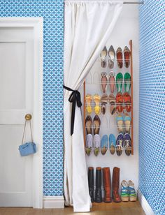 Shoe closet inside of a niche. I would rather have shelves to place them on instead of an actual shoe rack though. With different wall and curtain colors... It would be fabulous!