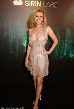 Lending her star power: Rachel Riley was glittering in gold at the bash...