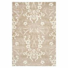 "Adorned with a damask-inspired motif, this loomed shag rug brings a touch of luxe appeal to your floors.    Product: RugConstruction Material: PolypropyleneColor: Beige and creamFeatures:   Dense shag pileHigh-low pile construction Pile Height:  1""Note: Please be aware that actual colors may vary from those shown on your screen. Accent rugs may also not show the entire pattern that the corresponding area rugs have.Cleaning and Care: Professional cleaning recommended"