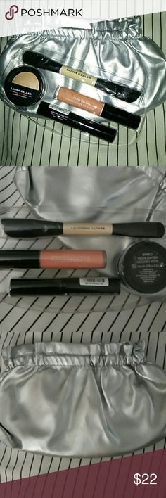 Laura Geller Gift set in bag- NEW This is a super cute silver makeup bag with Amazing Laura Geller makeup- All Laura Geller;  Glamlash dramatic volume mascara, baked highlighting powder in Golden Rose color,  Color Luster lip gloss in Pink Cake color,  and an awesome double-sided brush for face powder/foundation. These are all unopened still in plastic. Laura Geller  Makeup