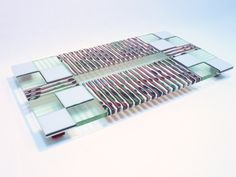 """This is a unique 16 flat serving plate in pink and light green. This piece of art has been made with great attention to detail using a technique called """"strip cut construction"""" where strips are cut from sheets of glass, and assembled on edge. The constructed design then goes to the kiln for a heating and cooling process of approximately 36 hours. Afterwards the edges were cut using a wet tile saw to provide smooth perfect finish to the plate. Following is a grinding and smoothing process…"""