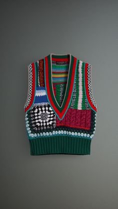 Burberry_A multicoloured tank top with a deep V-neck, artfully knitted in a wool, cashmere and cotton blend. Intricate crochet and embroidery, which take 12 hours to hand-stitch, complement the textural knit clash. Knitwear Fashion, Knit Fashion, Boho Fashion, Knitting Designs, Knitting Patterns, Crochet Patterns, Crochet Clothes, Diy Clothes, Pulls