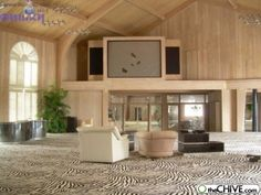mike tyson-abandoned mansion. the famous zebra carpet...love the beams