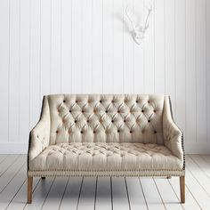 linen tufted settee with nail head & colored buttons