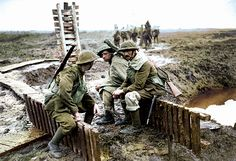 August 10, 1917 - Third Ypres: Offensive Postponed as British Wait for Break in Bad Weather Pictured - Slogging through the mud. Days of rainfall and artillery made the ground around Ypres almost impossible to move about in. Guns, men, and horses sank deep in a quagmire.